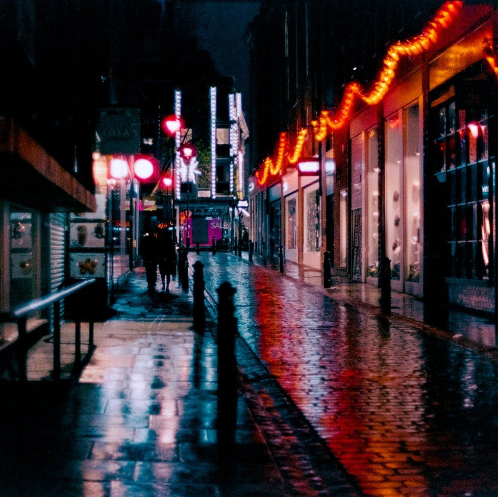 An image of a street emblazoned with lights