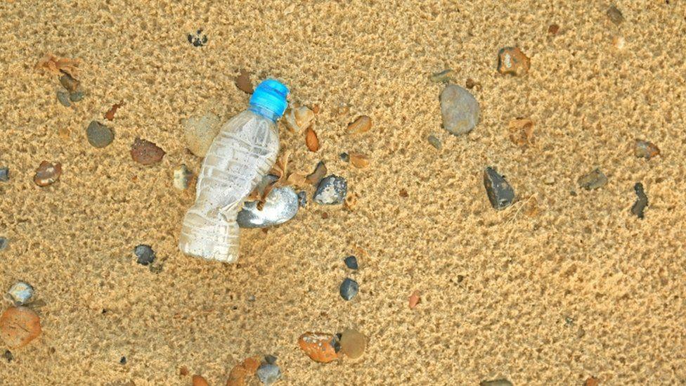 Plastic bottle on beach