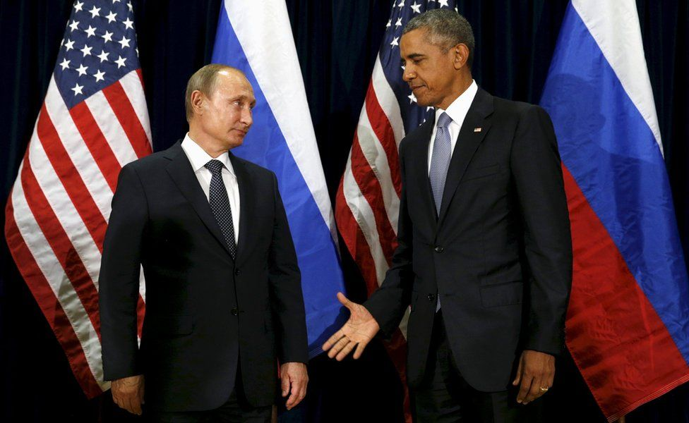 US President Barack Obama extends his hand to Russian President Vladimir Putin during their meeting at the United Nations General Assembly in New York, September 28, 2015.
