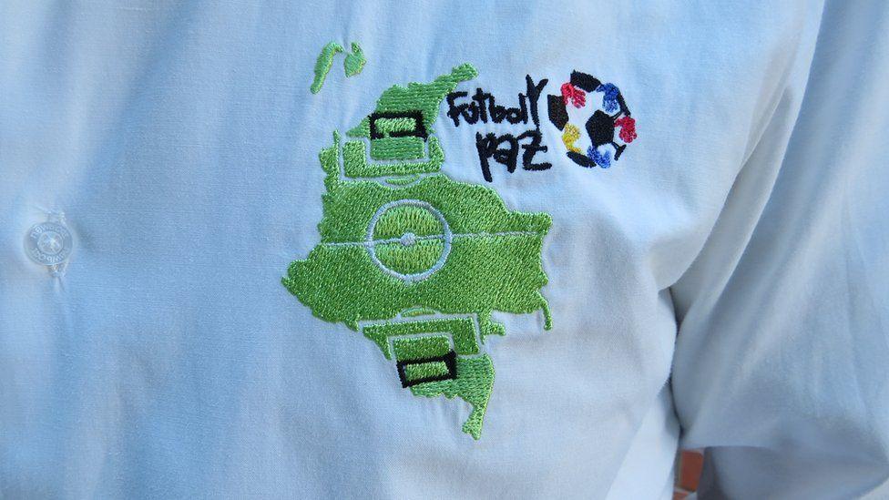 La Paz's logo can be seen on a football shirt