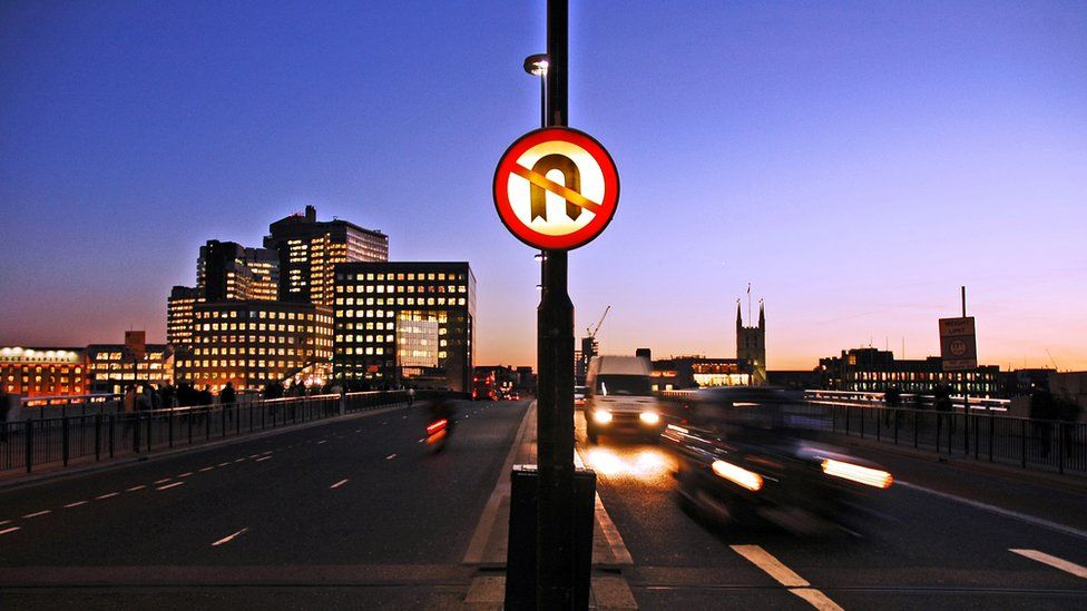 A no U-turn road sign on London bridge