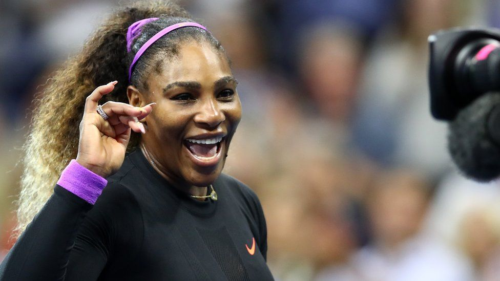 Serena Williams waves to camera