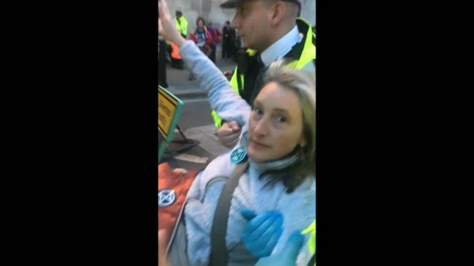 Jackie Jones being carried by police under arrest