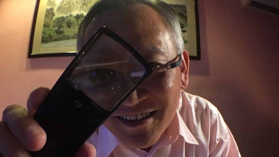 Richard Tan strikes a pose in his office