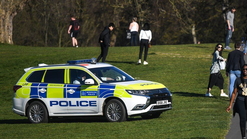 A police car is seen patrolling Greenwich Park on April 5, 2020 in London, England