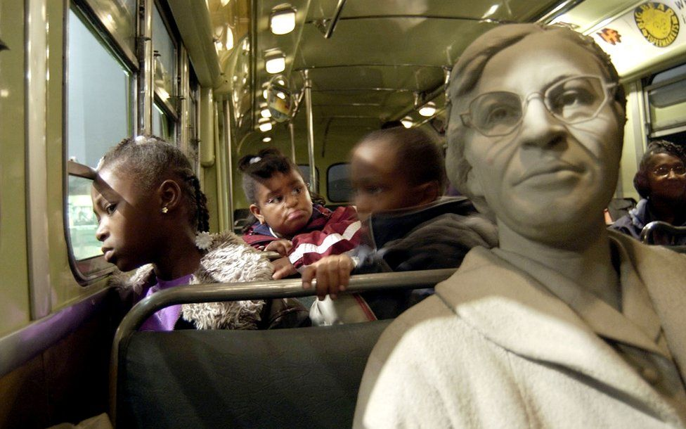Children next to a bust of Rosa Parks at the National Civil Rights Museum in Memphis, Tennessee