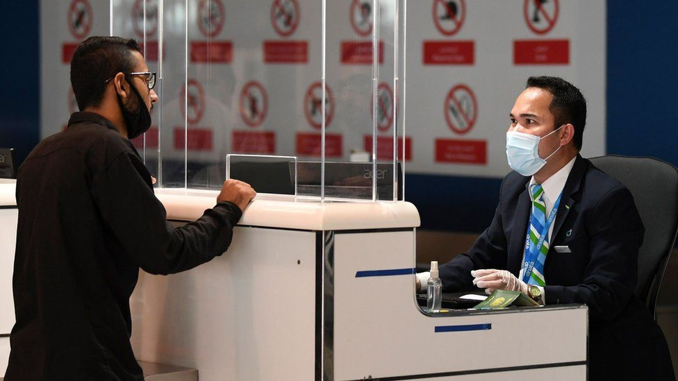 A Pakistani man checks in for a repatriation flight at Dubai's international airport on 7 May 2020