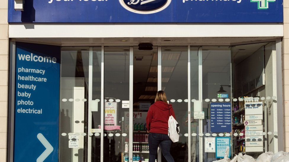 A sign is pictured above the entrance to a branch of Boots pharmacy in the town centre of Darlington, northern England on September 6, 2018