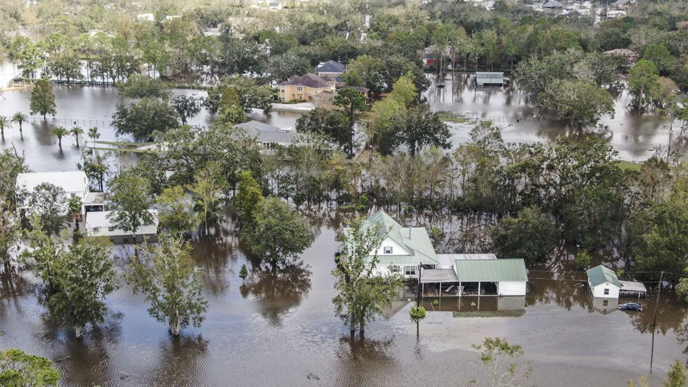 Aerial images show whole neighborhoods submerged.
