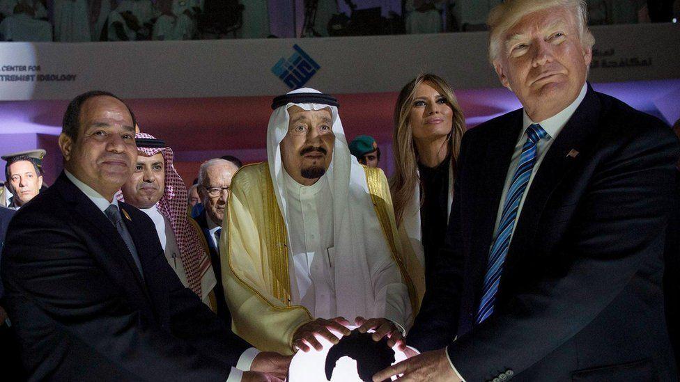 Egypt's Sisi, Saudi King Salman and Donald Trump pose with their hands on a globe
