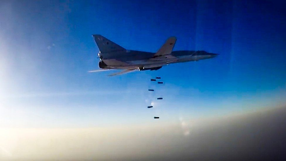 A still image, taken from video footage released by the Russian Defence Ministry on 16 August 2016, shows a Russian Tupolev Tu-22M3 long-range bomber based in Iran dropping bombs on an unknown location in Syria