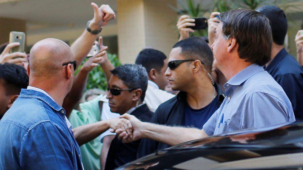 Brazil's President Jair Bolsonaro greets supporters in Brasilia