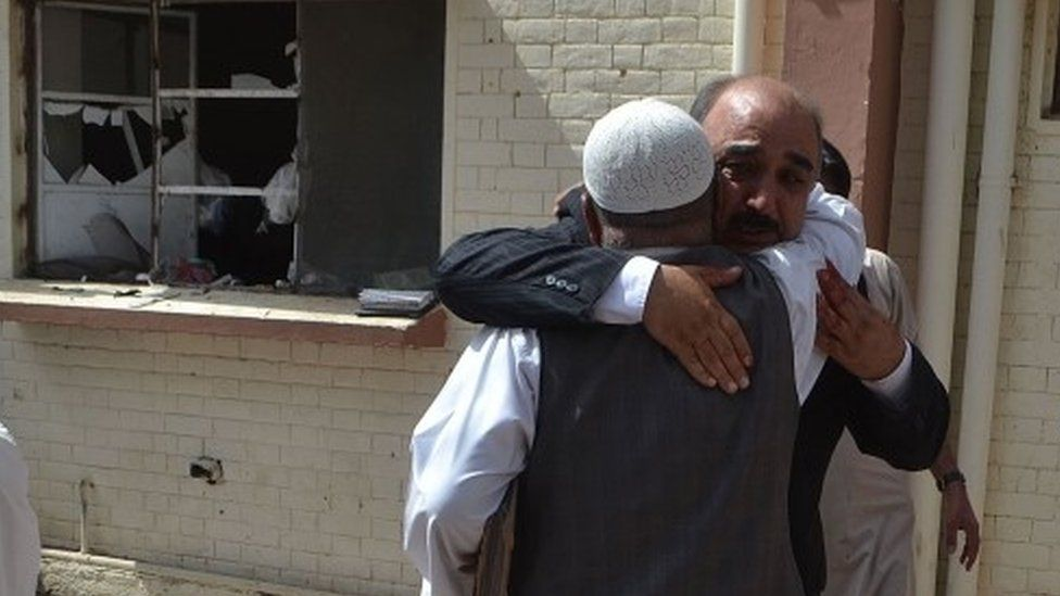 Survivors embrace after Quetta hospital blast