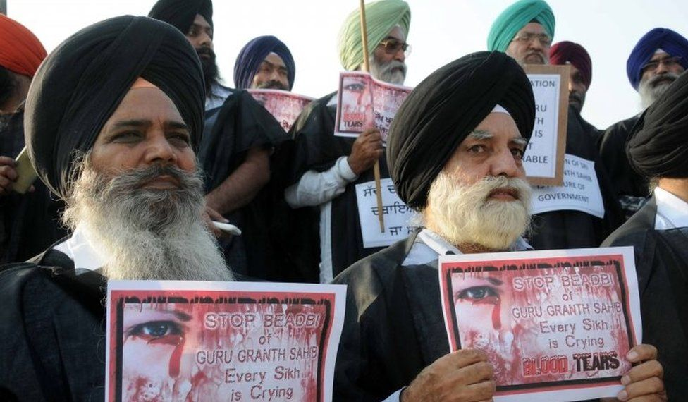 Sikh activists hold placards during a protest over an alleged desecration of the Sikh holy book, in Amritsar, India, 15 October 2015