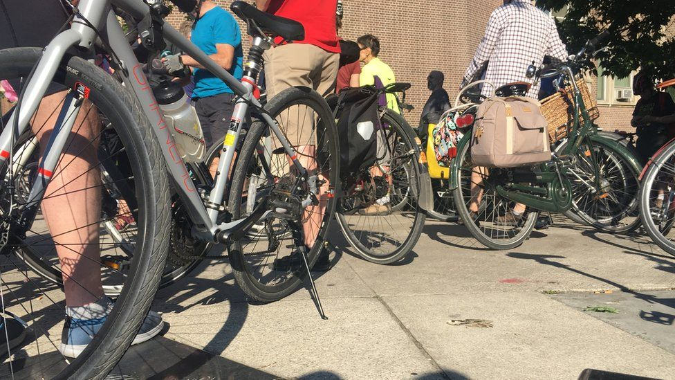 Cyclists gather in Toronto for a ghost bike ride