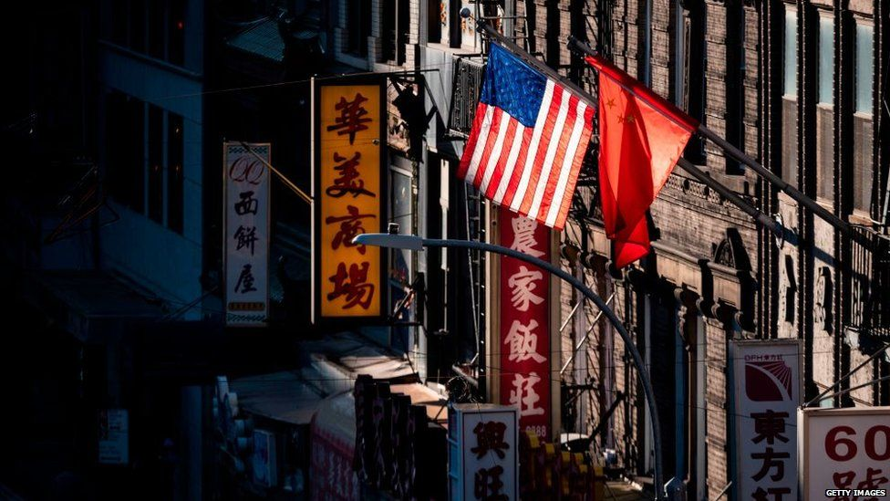 The PRC flag flies next to the US flag in Manhatten's Chinatown