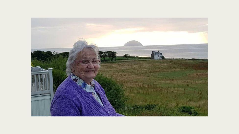 Kathleen Waugh sitting outside her holiday home near Girvan, Scotland.