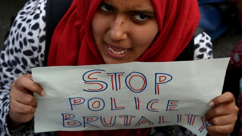 An Indian protester holds a placard during a protest in solidarity with Jamia Millia Islamia University students and against the Citizenship Amendment Bill (CAB) and National Register of Citizens (NRC), in Bangalore, India,