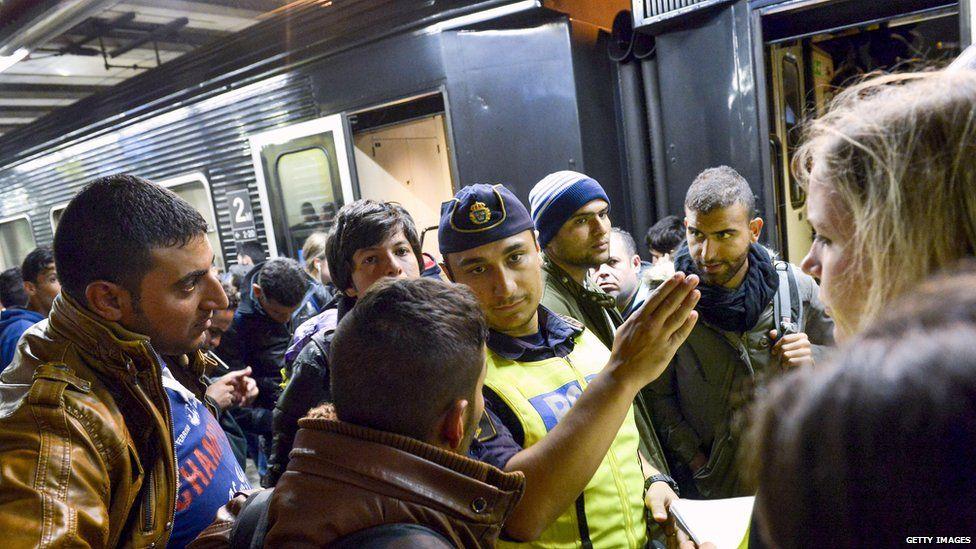 Refugees arrive at Stockholm station