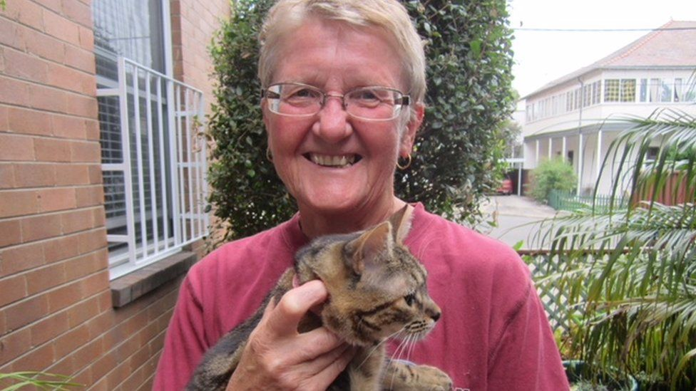 Kate Rowe pictured in recent times, holding a cat