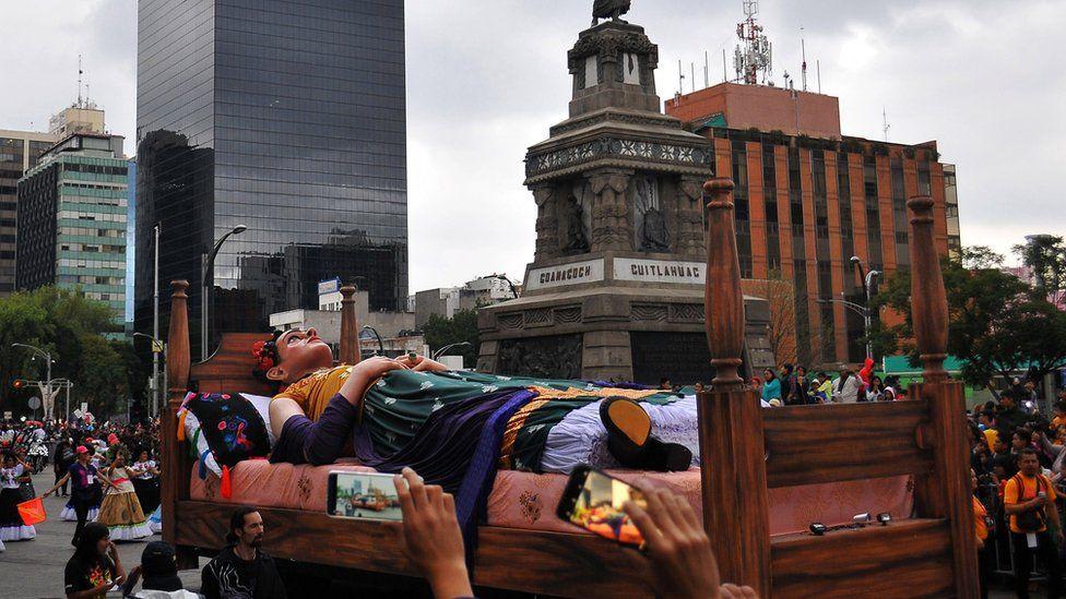 A large parade float of Frida Kahlo