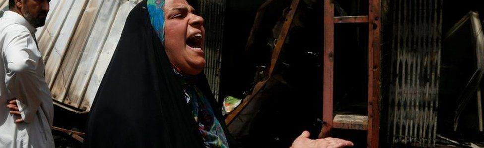 A woman reacts at the scene of a car bomb attack in Baghdad's mainly Shia district of Sadr City
