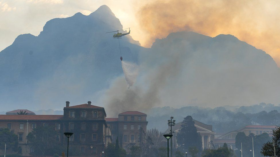 A helicopter battles a blaze that destroyed the nearly 200-year-old Jagger Library on the University of Cape Town (UCT) campus