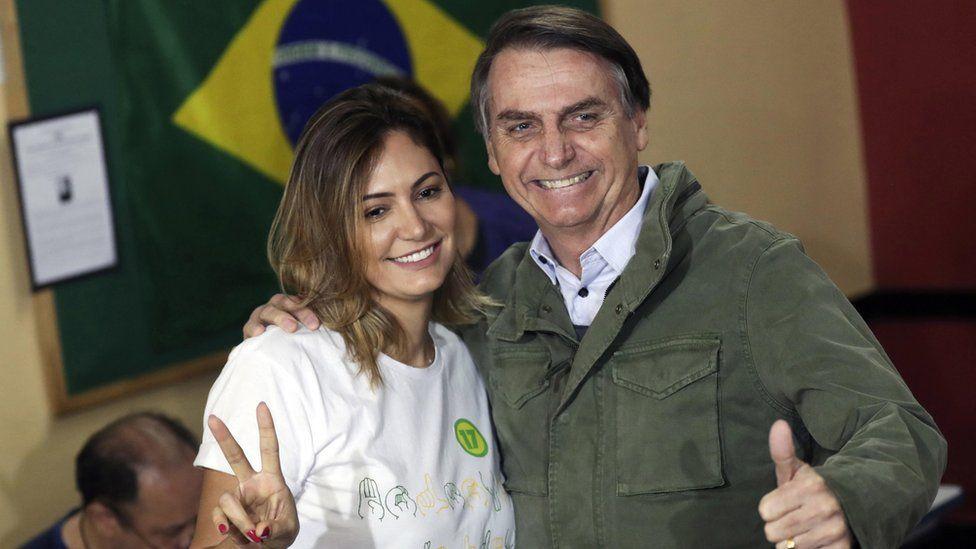 Mr Bolsonaro, right, and his wife Michelle voting in Rio de Janeiro