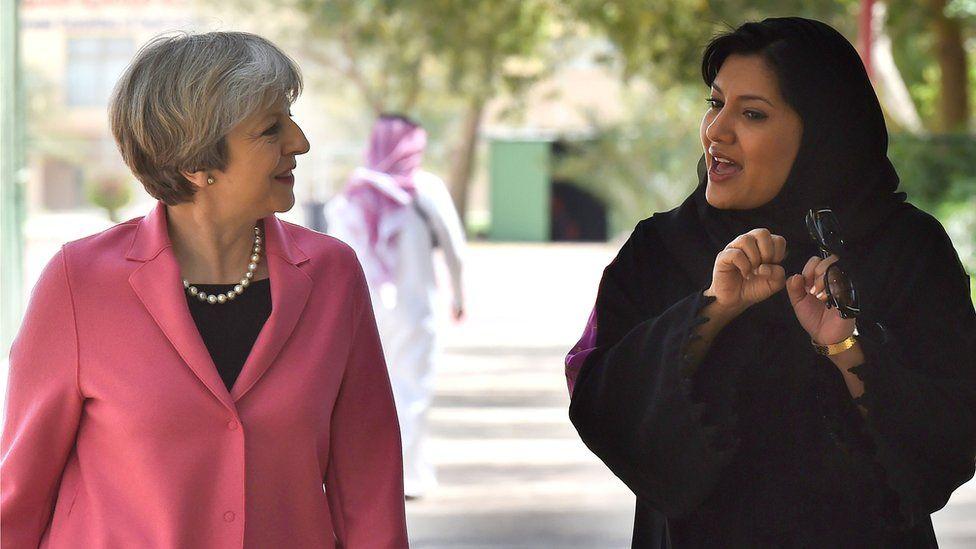 British Prime Minister Theresa May (L) walks alongside the Saudi Princess Reema Bint Bandar al-Saud in 2017