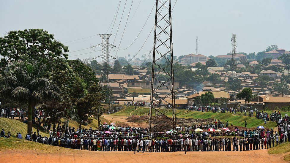 People line up to cast their vote in presidential and parliamentary polls in Mukono District