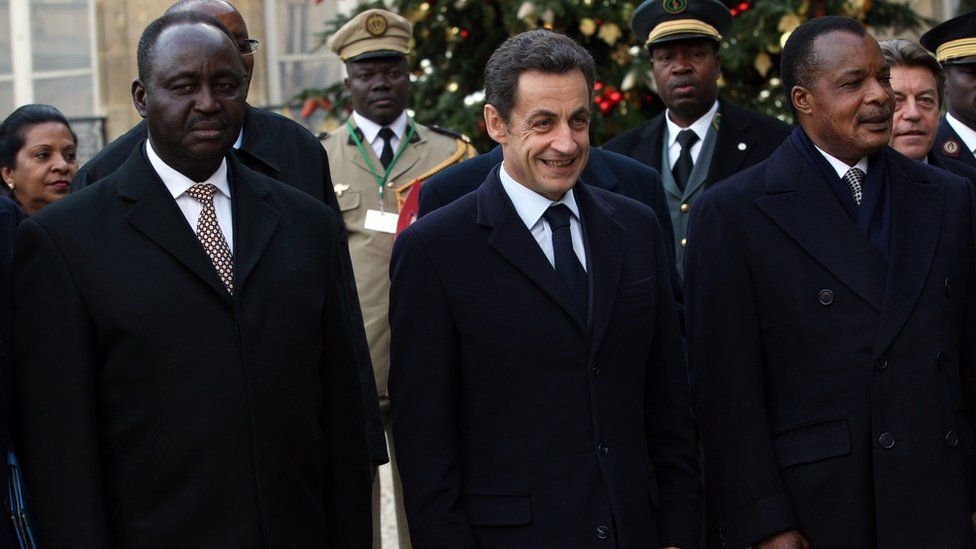 Former French President Nicolas Sarkozy with two African heads of state