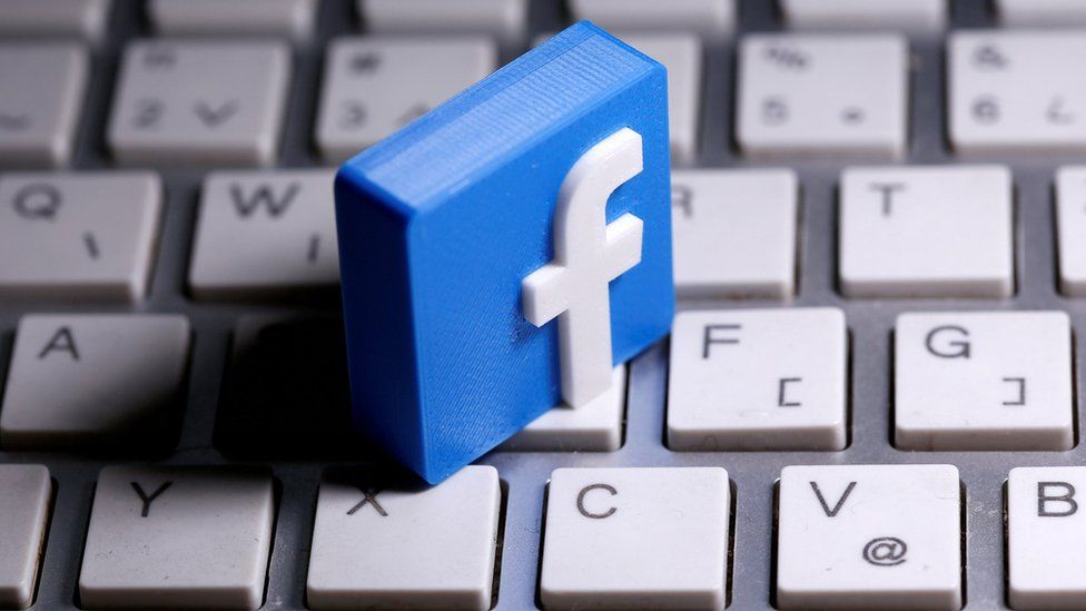 3D-printed Facebook logo is seen placed on a keyboard in this illustration taken March 25, 2020.