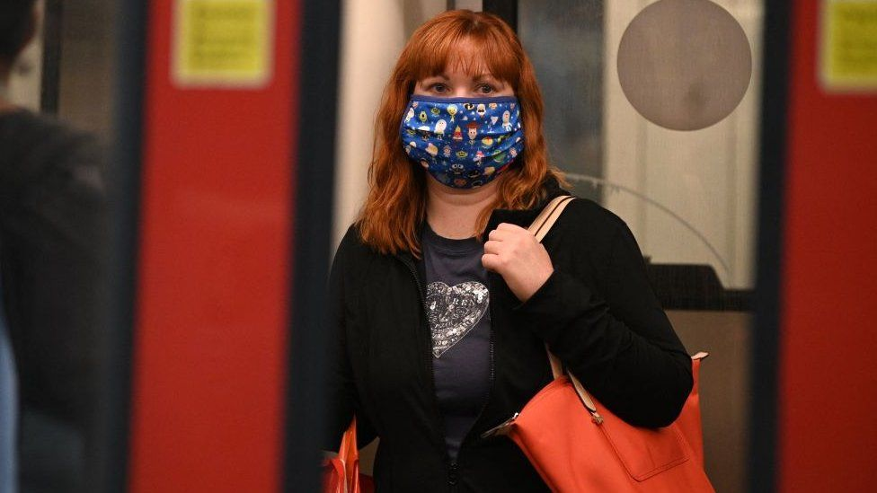 Woman commuting and wearing a mask