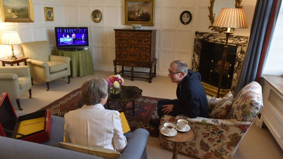 Theresa May and husband Philip watching ITV show The Chase at Chequers