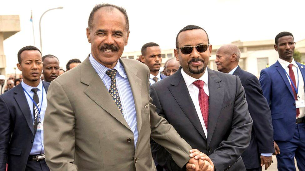 Isaias and Abiy hold hands