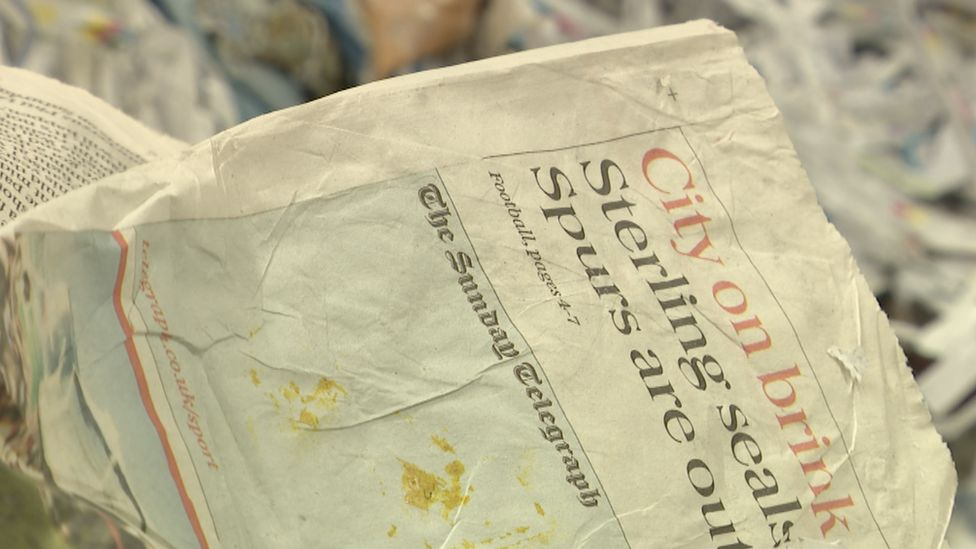 An edition of the Sunday Telegraph at a paper recycling plant in Gujarat