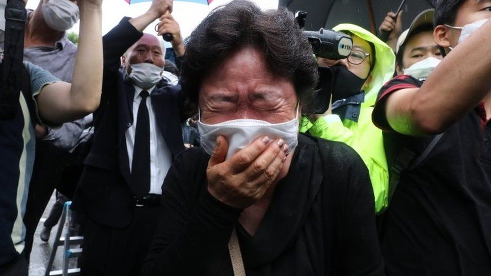 A mourner at the funeral on Monday