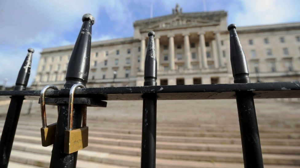 A padlock in front of Stormont