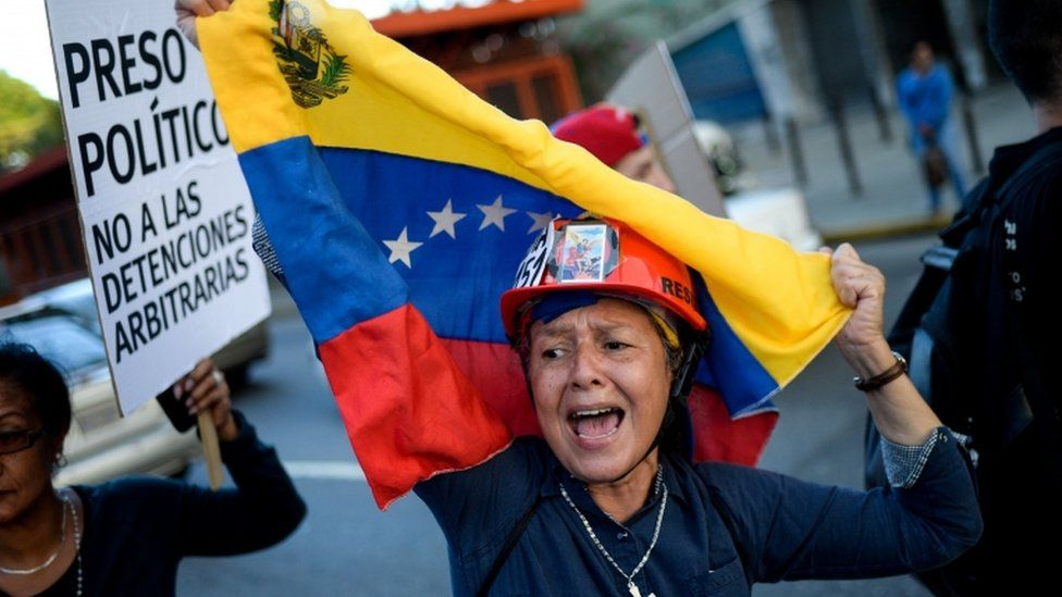 Venezuelan opposition activists carry out a peaceful demonstration