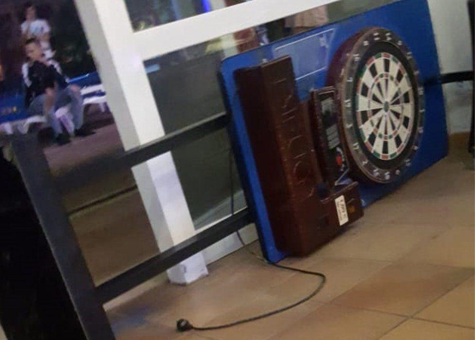 The arcade darts machine which fell on him