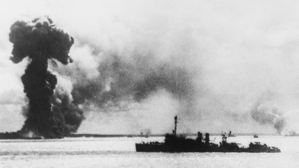 An image from 1942 shows an Allied ship near a huge plume of smoke caused by a bomb