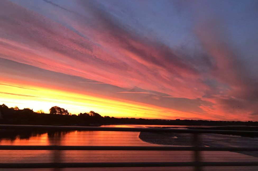 Colourful skies over a river