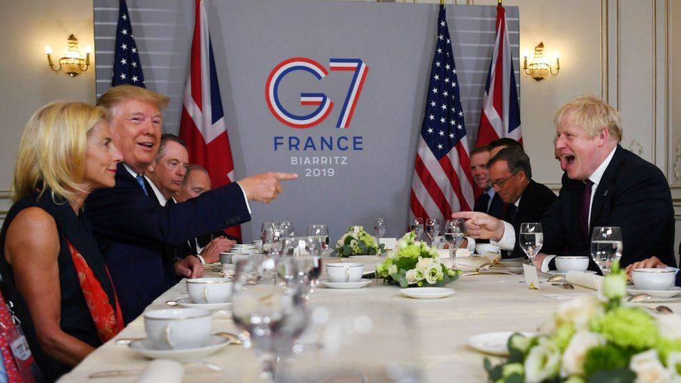 Trump and Johnson share laughs at the 2019 summit in France