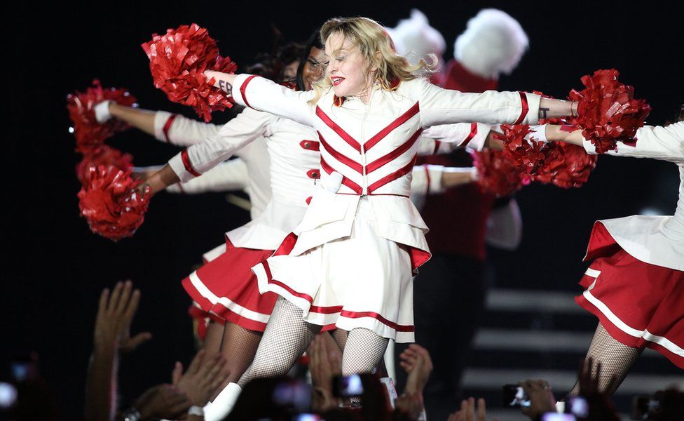 Madonna performs on stage with dancers in Nice southeastern France, as part of her MDNA world tour