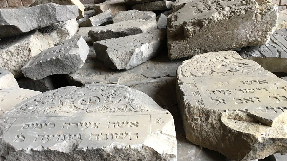 Smashed gravestones from Jewish cemetery