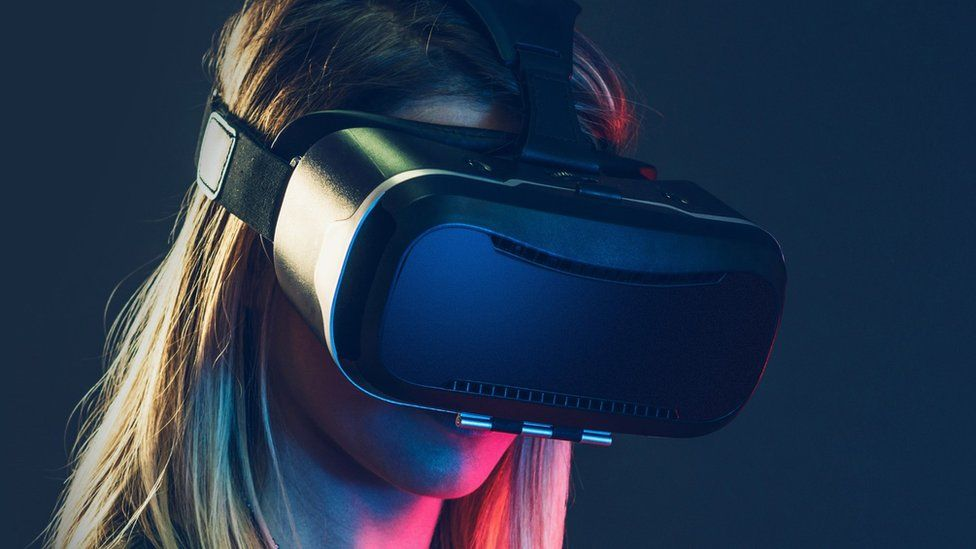 A woman in a VR headset