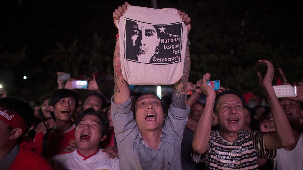 National League of Democracy (NLD) supporters celebrate outside NLD headquarters in Yangon