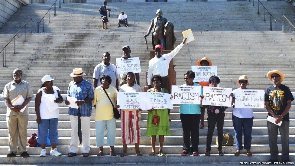 Plantersville residents protest on the steps of the Capitol in Clumbia