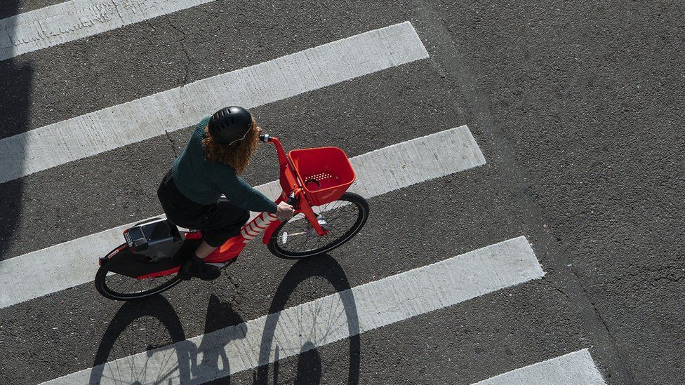 A woman riding a Jump Bike