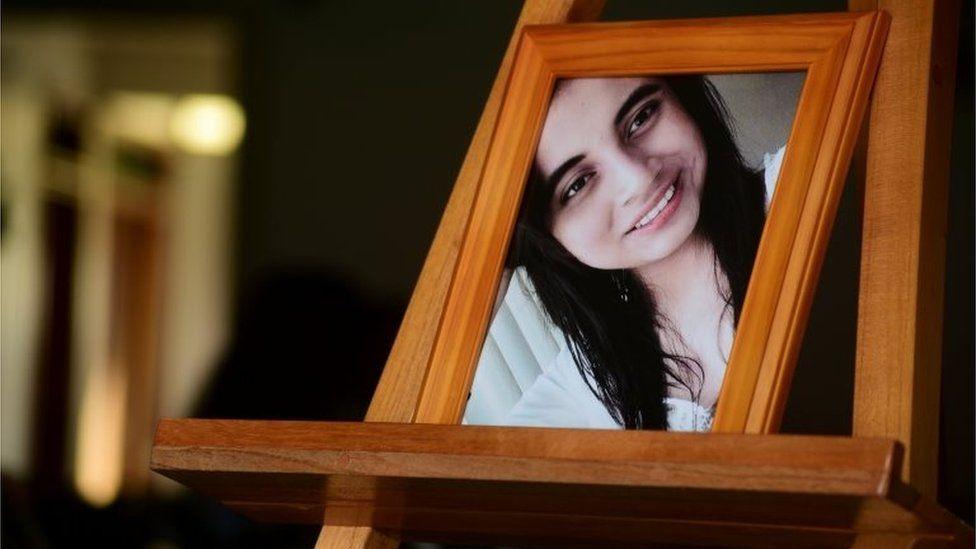 A portrait of Valeria Medel is seen during the wake in Ciudad Mendoza